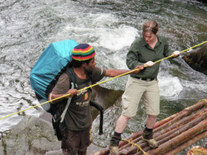 Crossing a log bridge with a personal porter